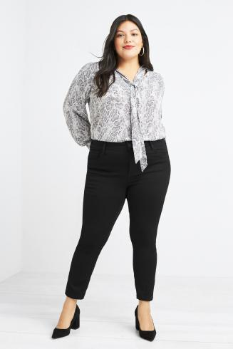 Stitch Fix women's clothes including black skinny jeans, black heels and grey printed blouse with tie detail.