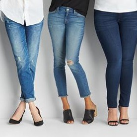Three pairs of jeans in medium and dark washes.