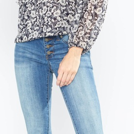 Medium wash jeans with floral top.