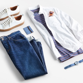 An outfit including jeans, sneakers and shirts.