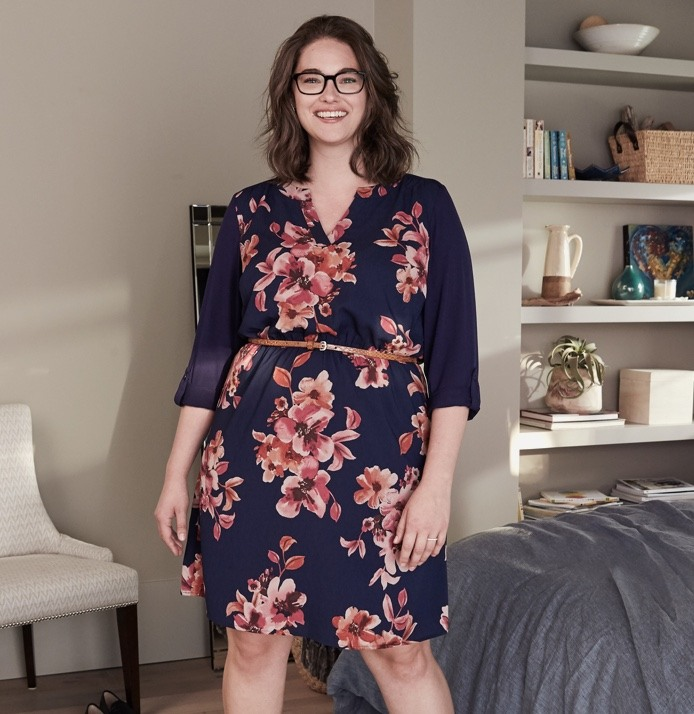 Navy blue floral dress with tunic collar and thin brown belt.