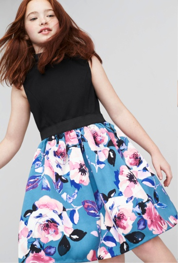 Blue floral skirt with black sleeveless top.