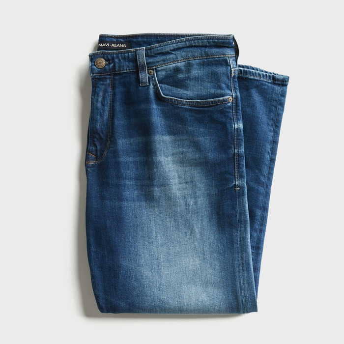 Distressed medium wash relaxed fit blue jeans.