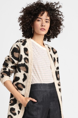 Stitch Fix women's clothes including white tee, cheetah print sweater and jeans.
