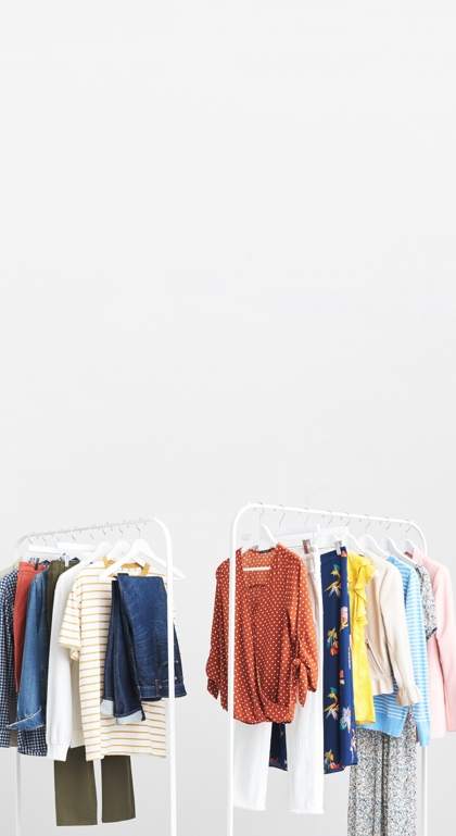 A variety of clothing styles hung from two racks.