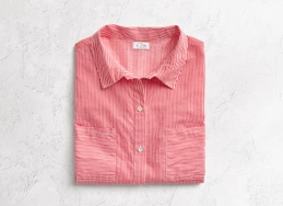 Coral striped button down top, folded.