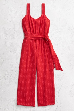 Red polka dot jumpsuit with tie detail and pockets lay-down.