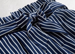 Navy blue and white striped shorts lay-down.