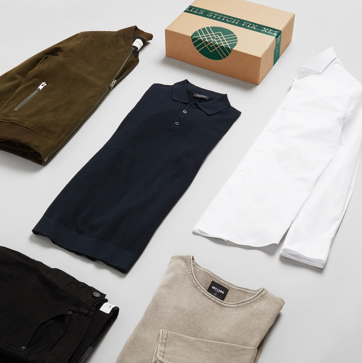 Men's clothing laid down beside a box
