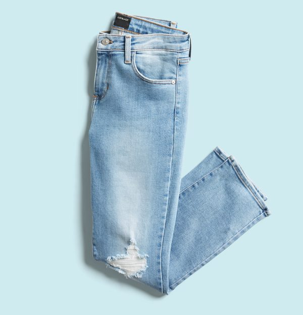 Light wash jeans with knee distressing.
