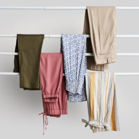 Five pairs of pants in various colors.