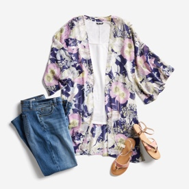 Purple floral maternity top with jeans and sandals.