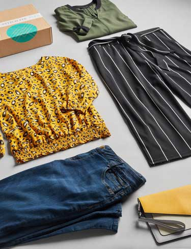 Stitch Fix box and clothing lay-down.
