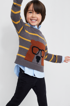 Kids clothes including a grey striped bear sweater with black pants.