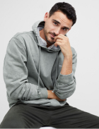 Grey hoodie sweatshirt with black pants.