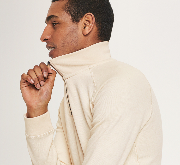 Ivory zip-neck sweatshirt.