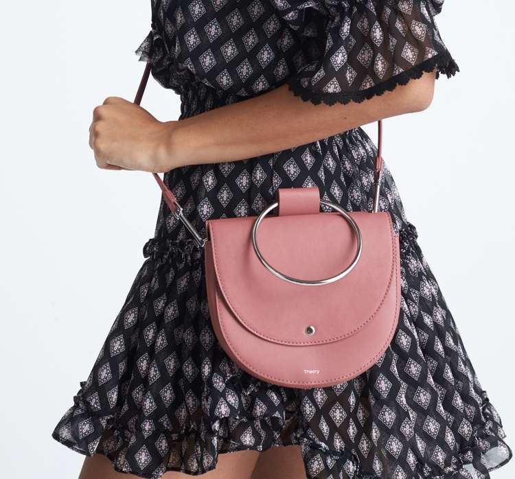 Blue and pink patterned dress with pink purse.
