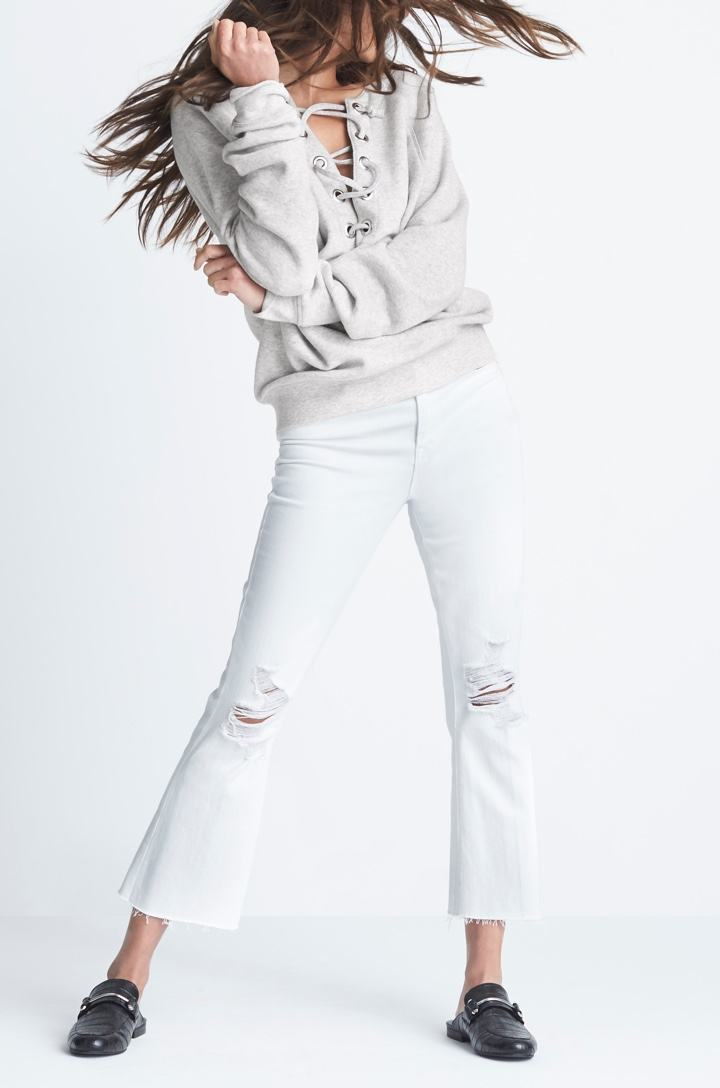 Grey lace-up front sweatshirt with white jeans.