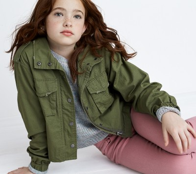 Stitch Fix Kids outfit including an olive green utility jacket, grey tee and pink denim pants.