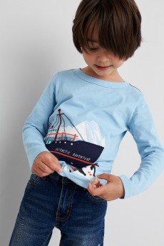 Stitch Fix Kids clothes including blue graphic boat shirt and jeans.
