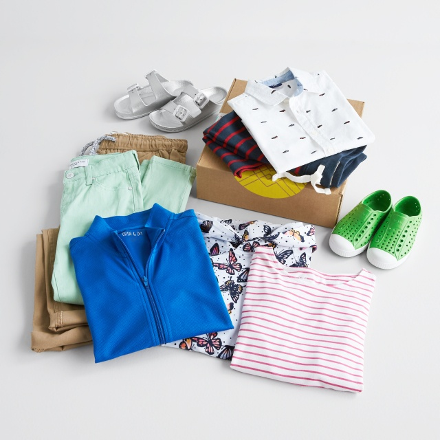 Kids clothes including sandals, sneakers, green pants, striped shorts, white patterned button short, blue zip jacket and tops in butterfly and red stripe prints.