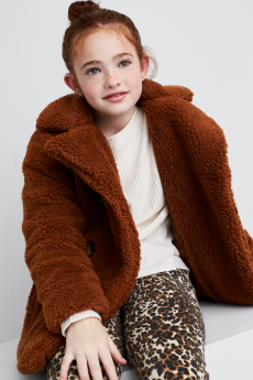 Stitch Fix Kids clothes including brown faux fur coat, white tee and brown print leggings.
