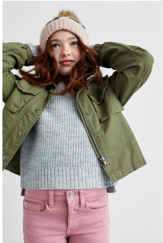 Stitch Fix Kids clothes including grey sweater, olive jacket, knit hat and pink jeans.