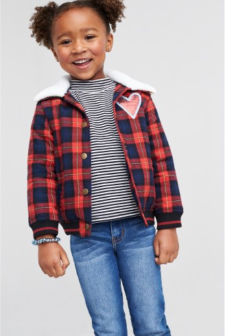 Stitch Fix Kids clothes including red and blue plaid jacket with grey shirt and jeans.