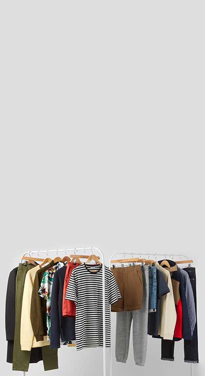 men's clothes hanging from two clothing racks