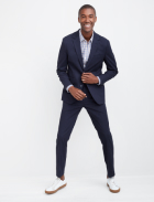 Men's clothes including a navy blue suit and plaid shirt with white sneakers.