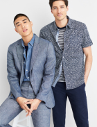 Men's clothes including a grey suit, denim shirt, black and white striped tee and printed shirt with blue pants.