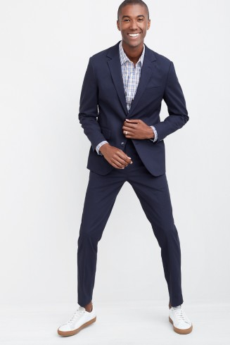 Stitch Fix men's clothes including a blue button shirt and navy suit coat and slacks with white sneakers.