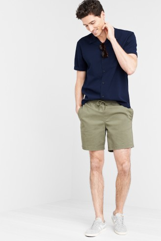 Stitch Fix men's clothing outfit including a navy tee, olive green mid-length shorts and white sneakers.