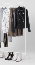 White clothes rack with tops, jacket, bottoms and shoes.