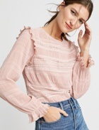 Light pink ruffles and lace top with jeans.
