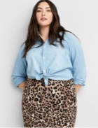 Light wash denim shirt with leopard print skirt.