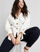 White button top with tie detail and black pants.