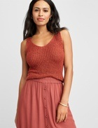 Coral sleeveless knit tank top with cotton skirt.