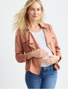 Peach leather jacket with white tee and jeans.