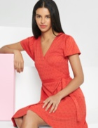 Coral v-neck wrap dress with tie detail.