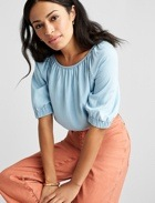 Light blue peasant top with coral pants.