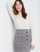 White top with black and grey plaid skirt.