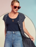 Navy tee with jeans and blue and white polka dot top.