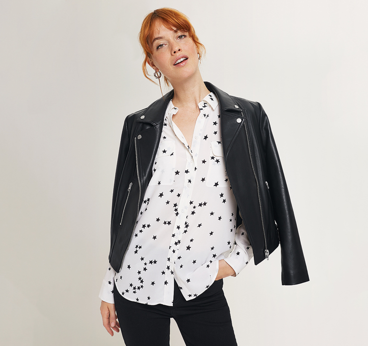 White shirt with black star pattern, black leather biker jacket and black pants.