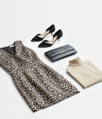 Leopard print dress, black shoes and clutch, and cream turtleneck.