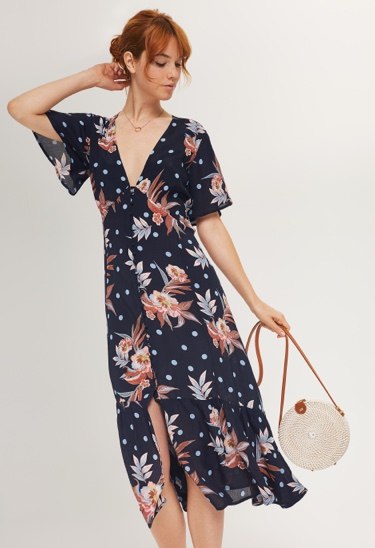 Navy blue and floral v-neck dress and ivory circle cross body handbag.