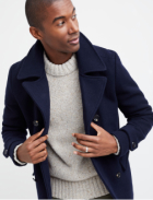 Navy blue peacoat over a light grey sweater.