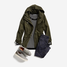 Olive jacket, striped tee, jeans and sneakers.