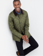 Olive quilted jacket with black pants.