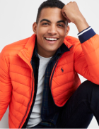 Orange puffer jacket with white tee and dark pants.